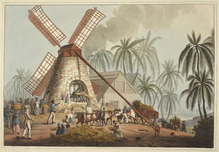 """<span class=""""caption"""">An illustration of a sugar plantation in Antigua.</span> <span class=""""attribution""""><a class=""""link rapid-noclick-resp"""" href=""""https://en.wikipedia.org/wiki/Sugar_plantations_in_the_Caribbean#/media/File:The_Mill_Yard_-_Ten_Views_in_the_Island_of_Antigua_(1823),_plate_V_-_BL.jpg"""" rel=""""nofollow noopener"""" target=""""_blank"""" data-ylk=""""slk:The British Library"""">The British Library</a>, <a class=""""link rapid-noclick-resp"""" href=""""http://creativecommons.org/licenses/by-nd/4.0/"""" rel=""""nofollow noopener"""" target=""""_blank"""" data-ylk=""""slk:CC BY-ND"""">CC BY-ND</a></span>"""