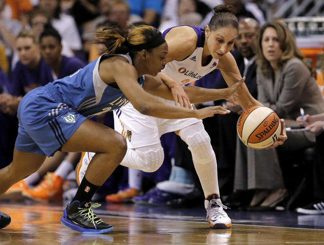 Minnesota Lynx guard Monica Wright, left, knocks the ball loose from Phoenix Mercury guard Diana Taurasi during the first half of a WNBA basketball game, Wednesday, June 19, 2013, in Phoenix. (AP Photo/Matt York)