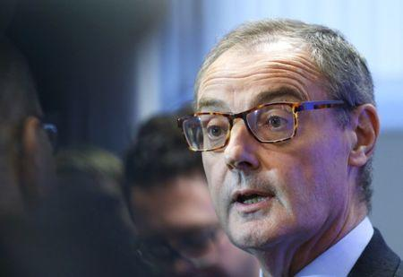 FILE PHOTO: David O'Sullivan takes part in a news conference after a meeting in Brussels October 16, 2014.   REUTERS/Yves Herman