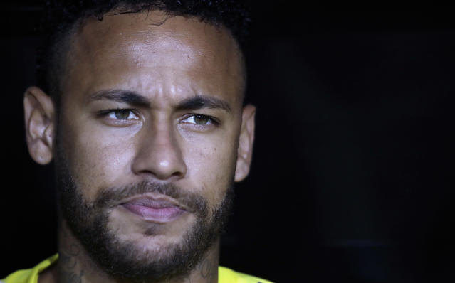 FILE - In this Tuesday, Sept. 10, 2019 file photo, Brazil's Neymar Jr. listens to his country's national anthem before an international friendly soccer match against Peru, in Los Angeles. Neymar is set to make his Paris Saint-Germain return after being included in the squad for their French league game at home to Strasbourg on Saturday, Sept. 14. (AP Photo/Marcio Jose Sanchez, file)