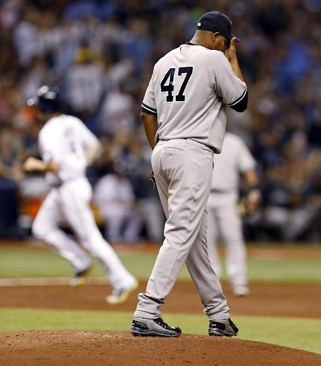 New York Yankees starting pitcher Ivan Nova reacts after giving up a home run to Tampa Bay Rays' Wil Myers during the second inning of a baseball game, Saturday, April 19, 2014, in St. Petersburg, Fla. (AP Photo/Mike Carlson)
