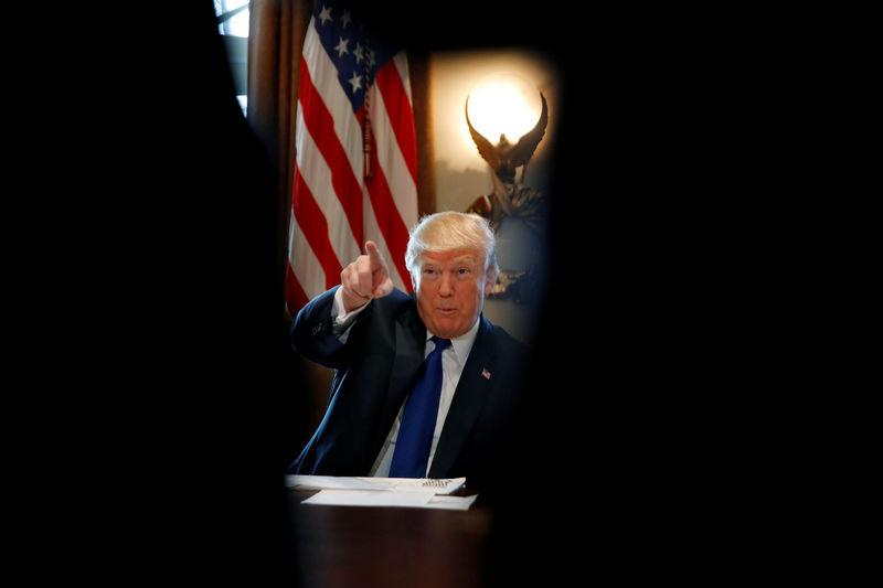 U.S. President Donald Trump talks with members of the press during a lunch with bicameral tax conferees in the Cabinet Room of the White House in Washington D.C.