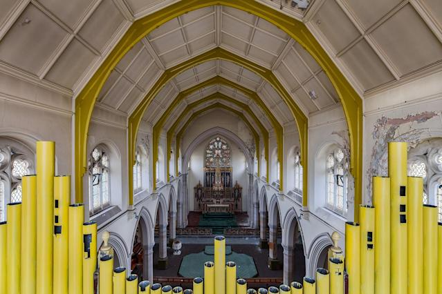 <p>Yellow pipe organ at a former British church. (Photo: James Kerwin/Caters News) </p>