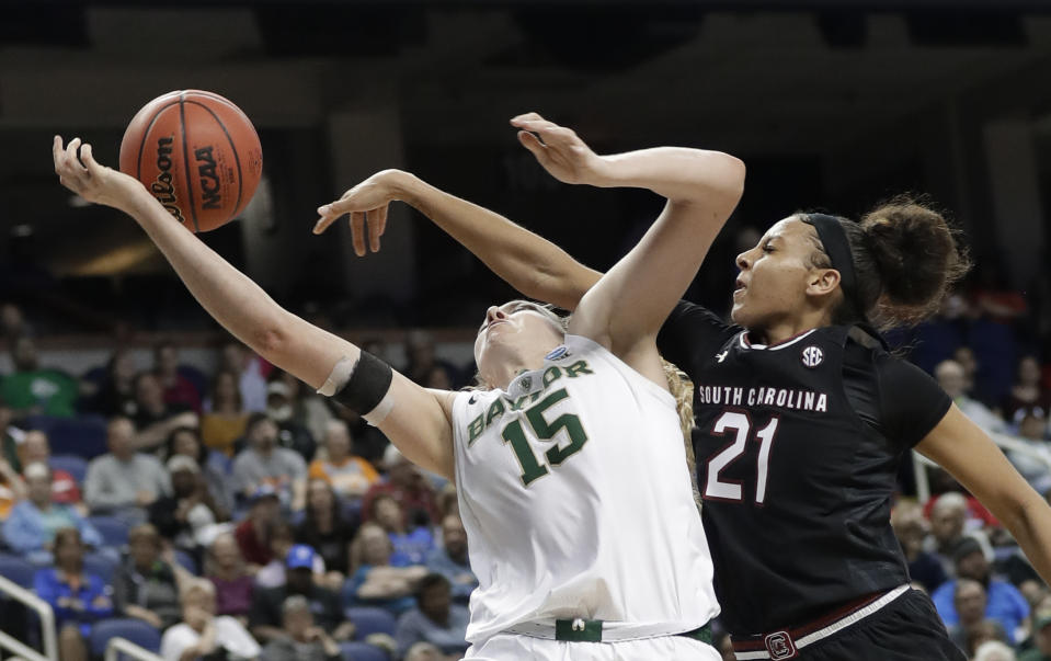 Baylor's Lauren Cox (15) is fouled by South Carolina's Mikiah Herbert Harrigan (21) during the second half of a regional women's college basketball game in the NCAA Tournament in Greensboro, N.C., Saturday, March 30, 2019. (AP Photo/Chuck Burton)