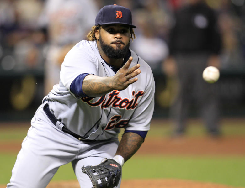 Detroit Tigers' Prince Fielder tosses the ball to relief pitcher Luke Putkonen at first base on a hit by Cleveland Indians' Jason Kipnis in the eighth inning in a baseball game, Tuesday, May 22, 2012, in Cleveland. Kipnis was safe at first base. The Indians won 5-3. (AP Photo/Tony Dejak)