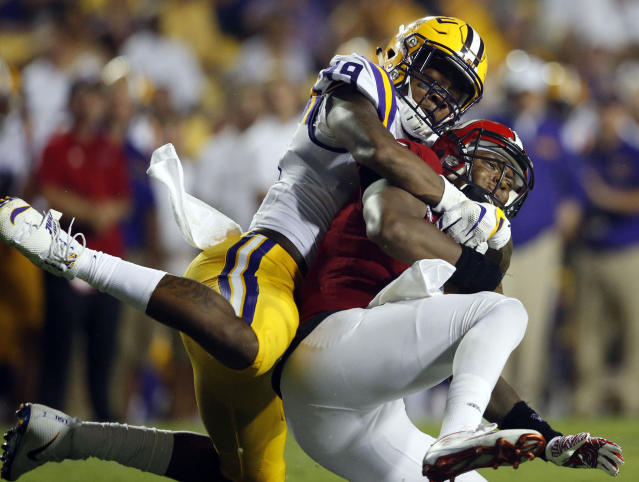 "This Sept. 10, 2016, file photo shows Jacksonville State quarterback Eli Jenkins being sacked by LSU defensive end <a class=""link rapid-noclick-resp"" href=""/ncaaf/players/250981/"" data-ylk=""slk:Arden Key"">Arden Key</a> (L). (AP Photo/Gerald Herbert, File)"