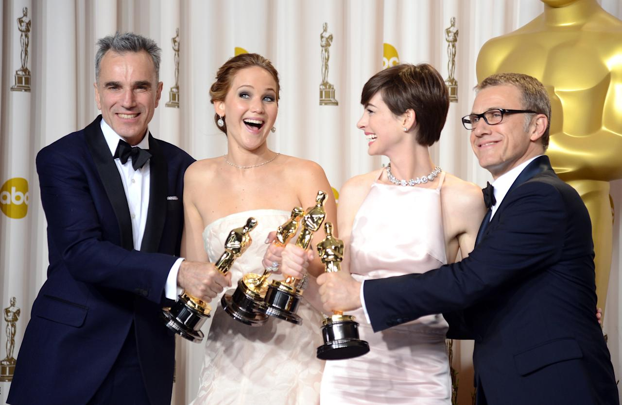 "(L-R) Actors Daniel Day-Lewis, winner of the Best Actor award for ""Lincoln;"" Jennifer Lawrence, winner of the Best Actress award for ""Silver Linings Playbook;"" Anne Hathaway, winner of the Best Supporting Actress award for ""Les Miserables;"" and Christoph Waltz, winner of the Best Supporting Actor award for ""Django Unchained,"" pose in the press room during the Oscars held at Loews Hollywood Hotel on February 24, 2013 in Hollywood, California.  (Photo by Jason Merritt/Getty Images)"