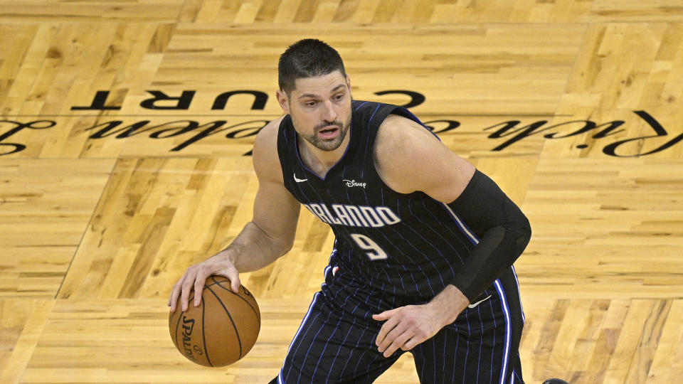Orlando Magic center Nikola Vucevic (9) sets up a play during the second half of an NBA basketball game against the Miami Heat on Sunday, March 14, 2021, in Orlando, Fla. (AP Photo/Phelan M. Ebenhack)