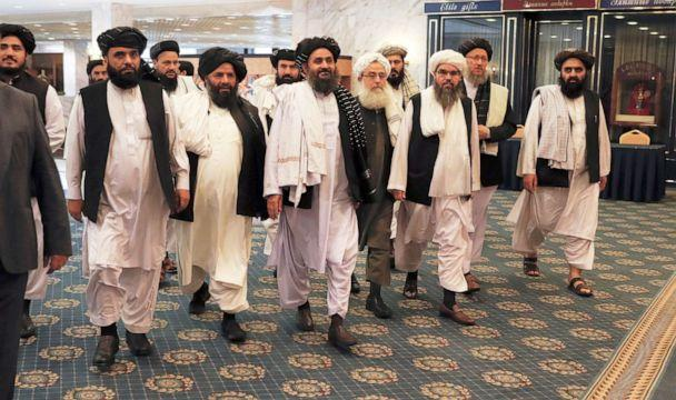 PHOTO: Members of a Taliban delegation, led by chief negotiator Mullah Abdul Ghani Baradar (C, front), walk before a meeting with Afghan senior politicians in Moscow, Russia, May 30, 2019. (Evgenia Novozhenina/Reuters, FILE)