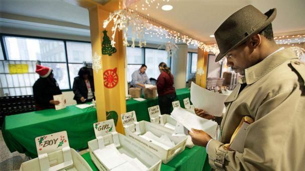 PHOTO: In this Dec. 21, 2011, file photo, Mel Roberson reads through letters from children as he participates in the U.S. Postal Service's Operation Santa program at the main post office in Chicago. (M. Spencer Green/AP, FILE)