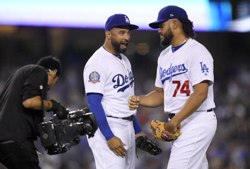 Los Angeles Dodgers left fielder Matt Kemp, center, congratulates relief pitcher Kenley Jansen after the Dodgers defeated the San Francisco Giants 3-2 in a baseball game Friday, June 15, 2018, in Los Angeles. (AP Photo/Mark J. Terrill)