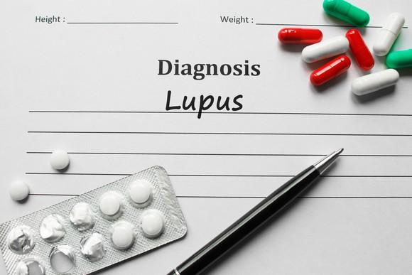 Form diagnosing lupus with medication and a pen
