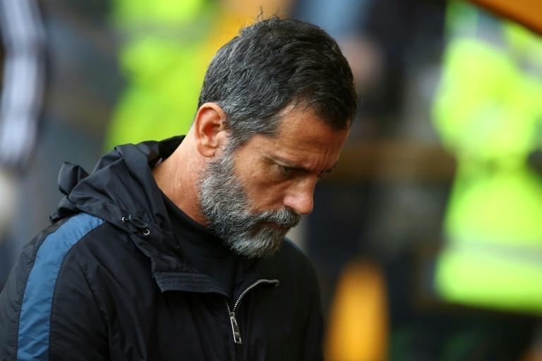 Down and out: Watford sacked Quique Sanchez Flores on Sunday (AFP Photo/GEOFF CADDICK)