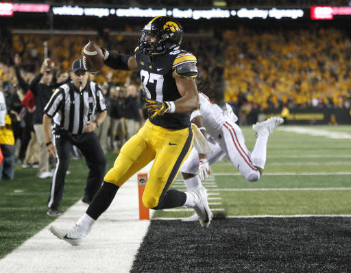 Iowa tight end Noah Fant runs in a touchdown during the second half of the team's NCAA college football game against Wisconsin, Saturday, Sept. 22, 2018, in Iowa City. (AP Photo/Matthew Putney)