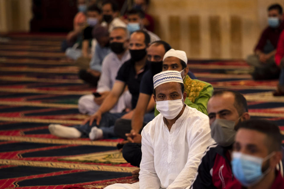 Muslim worshippers wearing masks to help stop the spread of the coronavirus, attend to offer Eid al-Adha prayer while maintaining a social distance at the Mohammad al-Amin Mosque in Beirut, Lebanon, Friday, July 31, 2020. Eid al-Adha, or Feast of Sacrifice, Islam's most important holiday marks the willingness of the Prophet Ibrahim to sacrifice his son. (AP Photo/Hassan Ammar)