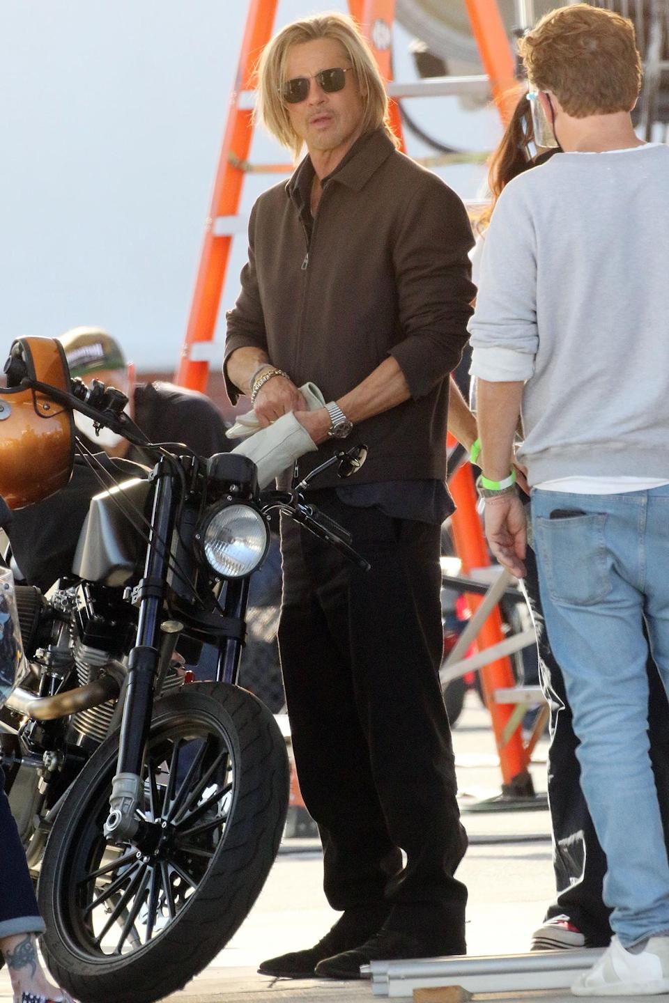 <p>Brad Pitt got ready to film commercial on a motorcycle in Los Angeles.</p>
