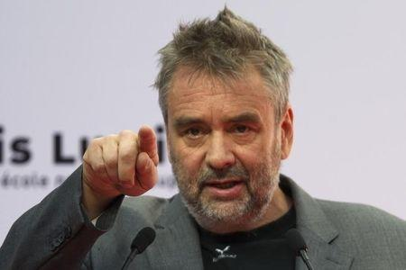 French film director Luc Besson attends the inauguration of the 'Cite du Cinema' movie studios in Saint-Denis