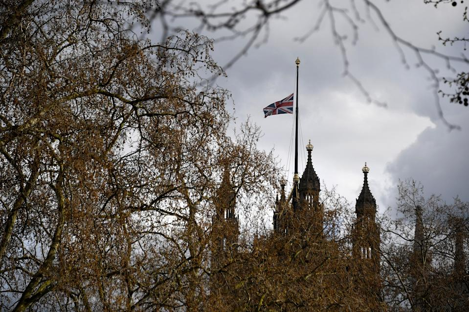 The Union flag flies at half staff over the Palace of Westminster (AP)