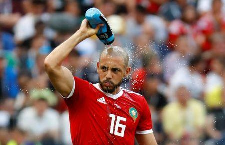 Soccer Football - World Cup - Group B - Portugal vs Morocco - Luzhniki Stadium, Moscow, Russia - June 20, 2018 Morocco's Nordin Amrabat splashes water on himself REUTERS/Kai Pfaffenbach