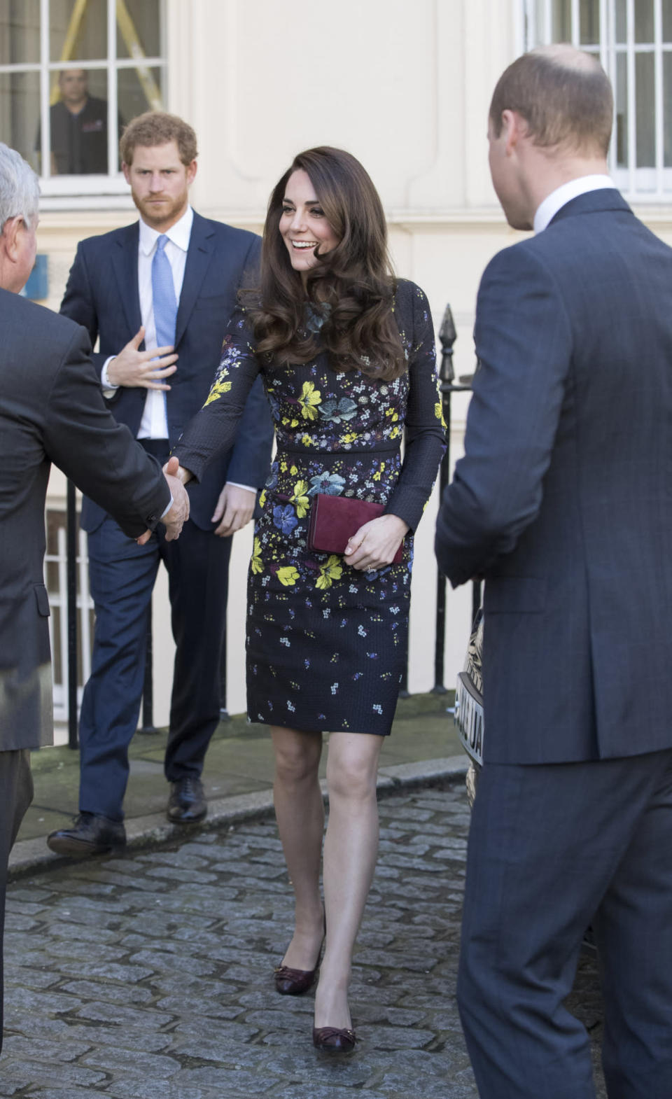 <p>The Duchess appeared perfectly coiffed at the ICA in London, wearing in a dark floral dress by Erdem (costing an eye watering £1050). Appearing in front of the media along with Princes William and Harry to outline her 2017 goals for Heads Together, Kate accessorised with brown buckled pumps and a burgundy suede clutch. </p><p><i>[Photo: Getty]</i></p>