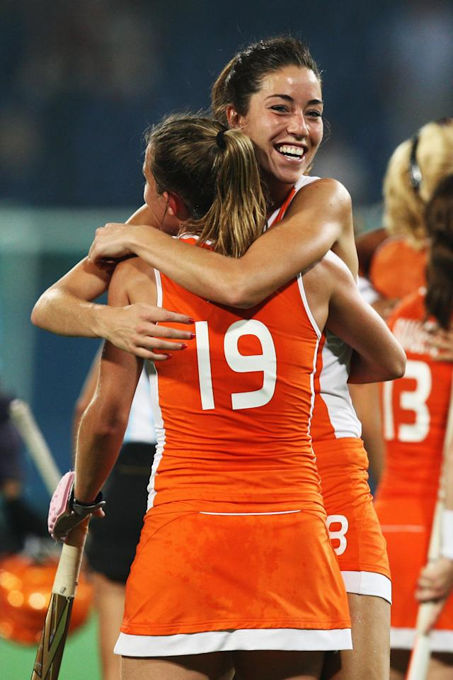 BEIJING - AUGUST 20: Naomi van AS #18 of Netherlands and her team mate Ellen Hoog #19 celebrate their victory after the Women's Semifinal 2 Match W34 between Netherlands and Argentina at the Olympic Green Hockey Field during Day 12 of the Beijing 2008 Olympic Games on August 20, 2008 in Beijing, China. (Photo by Quinn Rooney/Getty Images)