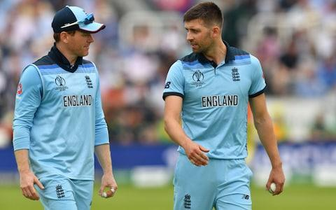 Eoin Morgan and Mark Wood chat - Credit: Getty images