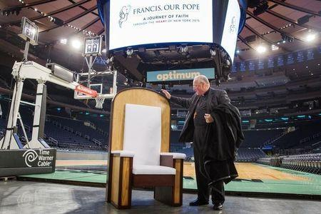 Archbishop of New York Timothy Michael Dolan speaks about a chair that will be used in Madison Square Garden for Pope Francis' upcoming Papal Mass in New York September 2, 2015. REUTERS/Lucas Jackson