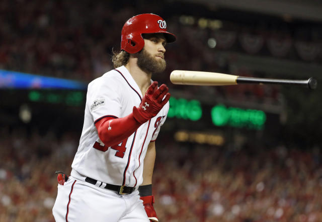 Washington Nationals' Bryce Harper flips the bat after hitting his two-run home run in the eighth inning in Game 2 of baseball's National League Division Series against the Chicago Cubs, at Nationals Park, Saturday, Oct. 7, 2017, in Washington. (AP)