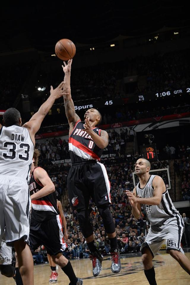 SAN ANTONIO, TX - January 17: Damian Lillard #0 of the Portland Trail Blazers shoots the ball against the San Antonio Spurs during the game at the AT&T Center on January 17, 2014 in San Antonio, Texas