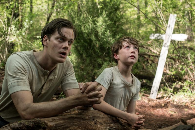 The Devil All The Time (L-R) Bill Skarsgård as Willard Russell, Michael Banks Repeta as Arvin Russell (9 Years Old). (Glen Wilson/Netflix © 2020)