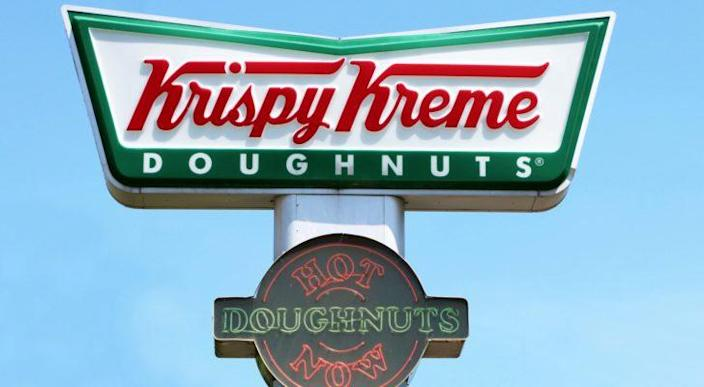 A close-up of a sign for Krispy Kreme (DNUT) donuts.