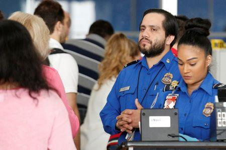 REFILE: UPDATING SLUG TO NEW YORK-AIRPORT/Transportation Security Administration (TSA) agents check-in passengers at JFK airport in the Queens borough of New York City, U.S., May 27, 2016.    REUTERS/Brendan McDermid/File Photo