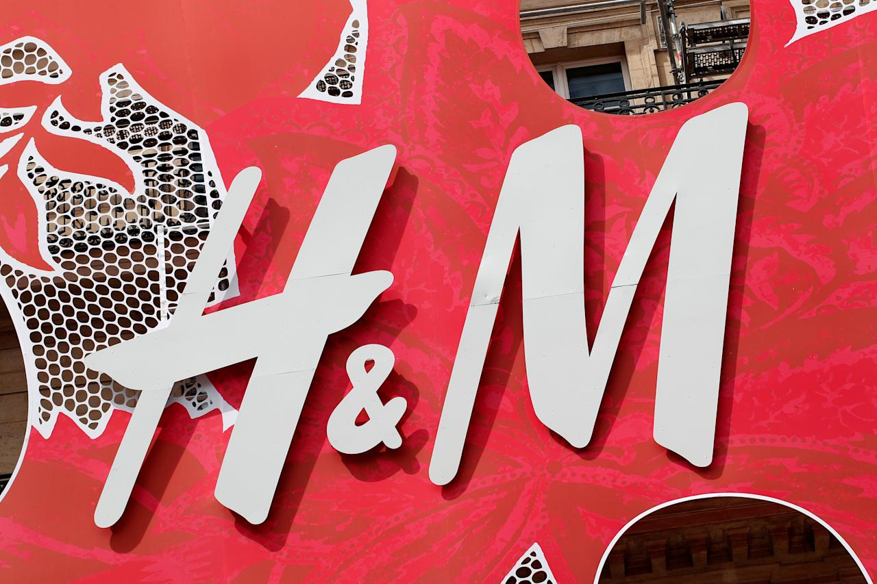 A Hennes & Mauritz AB (H&M) logo covers the facade of its flagship store in Paris, France, June 18, 2018. REUTERS/Benoit Tessier