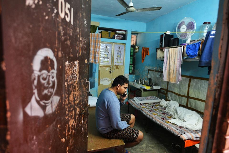 NEW DELHI, INDIA - JANUARY 6: Suryaprakash, a blind research scholar pursuing MPhil in Sanskrit, speaks on the phone while sitting in his room at Sabarmati Hostel, Jawaharlal Nehru University (JNU), on January 6, 2020 in New Delhi, India. He was also beaten up during yesterdays violence inside the campus. (Photo by Vipin Kumar/Hindustan Times via Getty Images)