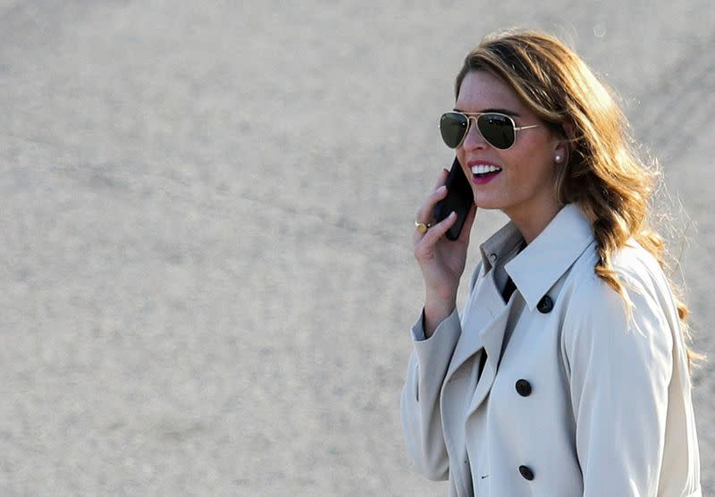 FILE PHOTO: White House counselor to the president Hope Hicks uses her smartphone at a campaign event for U.S. President Donald Trump at Dayton International Airport in Dayton