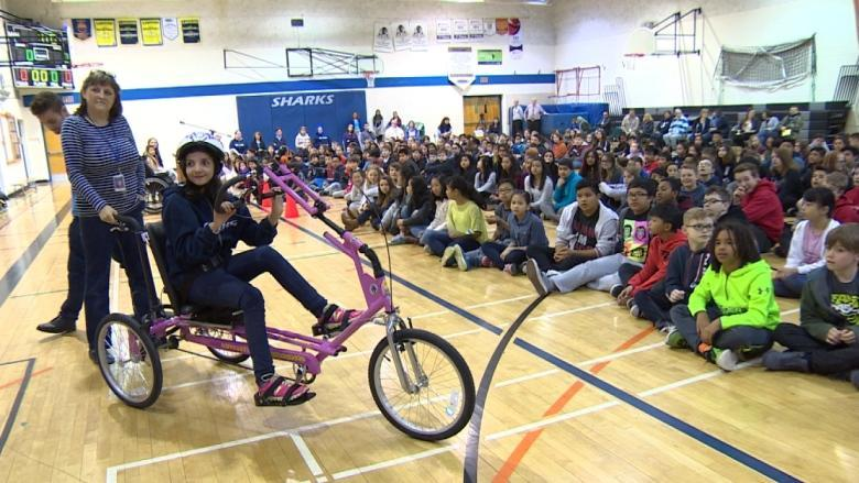 Pink custom trike a dream come true for 12-year-old Syrian refugee with cerebral palsy
