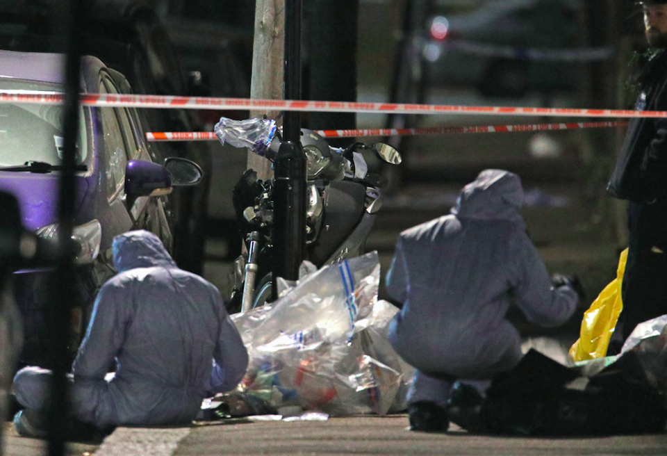<em>Forensic officers look for clues following the stabbing (PA)</em>