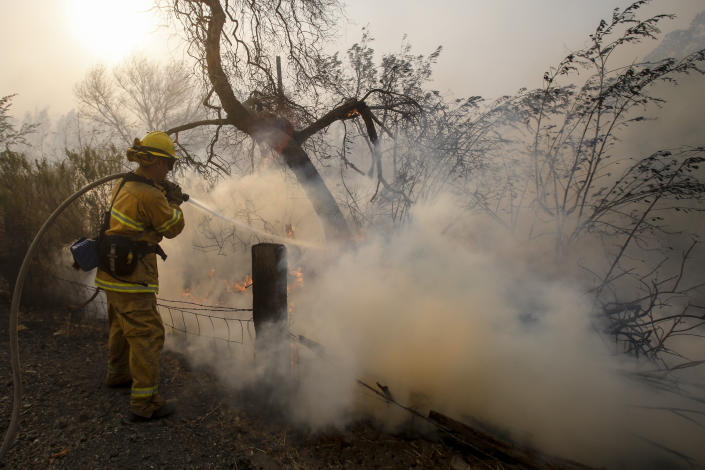 A firefighter battles a wildfire near a ranch in Simi Valley, Calif., Oct. 30, 2019. The large new wildfire erupted in wind-whipped Southern California, forcing the evacuation of the Ronald Reagan Presidential Library and nearby homes.(Photo: Ringo H.W. Chiu/AP)