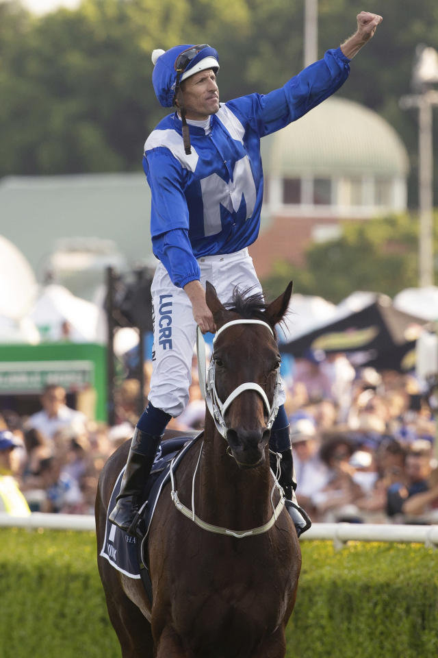 Jockey Hugh Bowman waves after riding Winx to victory in the Queen Elizabeth Stakes at Royal Randwick Racecourse in Sydney, Saturday, April 13, 2019. Seven-year-old mare Winx won her third consecutive Queen Elizabeth Stakes at Randwick to finish her illustrious career with a 33rd consecutive win, a record 25th Group One victory and nearly $19 million in prize money. (Steve Christo/AAP Image via AP)