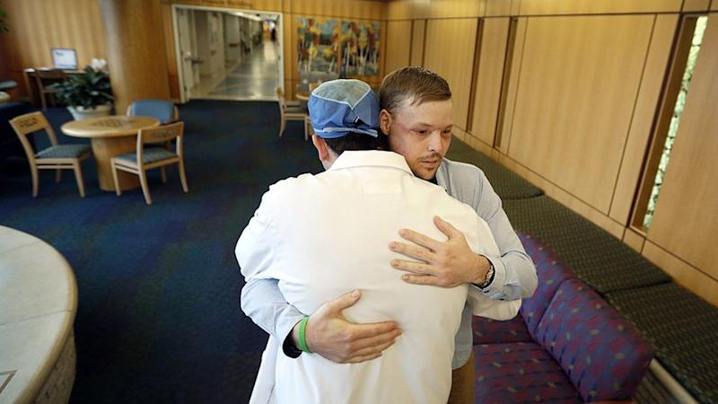 Andy is hugged by Dr. Samir Mardini after another follow up procedure at the Mayo Clinic in Minnesota in January. Source: AAP