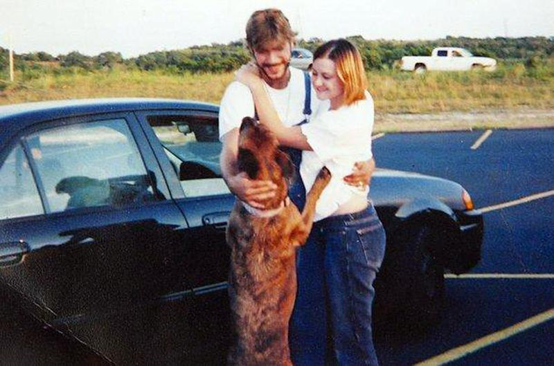 File - This undated file photo proved by the Medlen family shows Jeremy Medlen, left, and Kathryn Medlen with their dog, Avery. The Texas Supreme Court upheld Friday that the bereaved Forth Worth, Texas dog owners can't sue for emotional damages when someone else is to blame for the death of a pet. The family had challenged a law after an animal shelter mistakenly euthanized their Labrador retriever in 2009. (AP Photo/Medlen Family, File)
