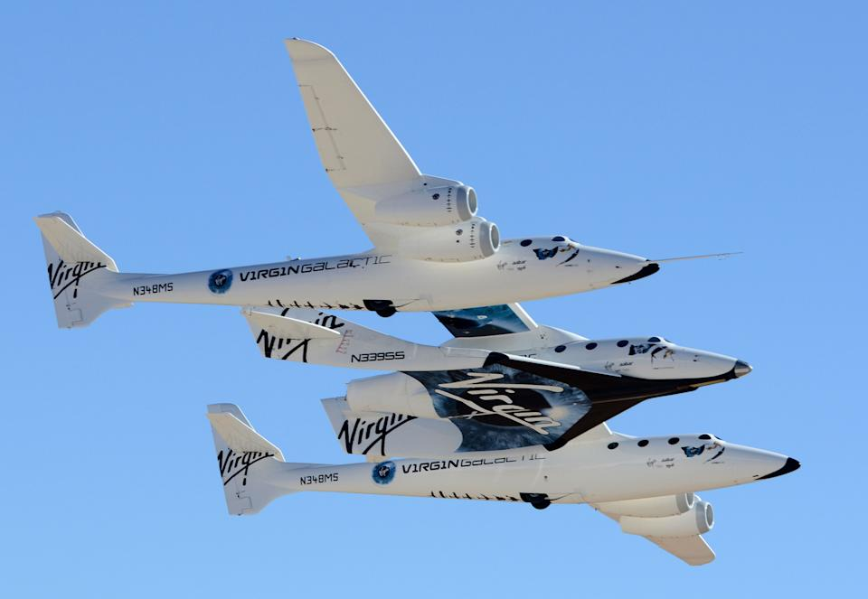 The White Knight II carrying Space Ship II flies above Spaceport America.