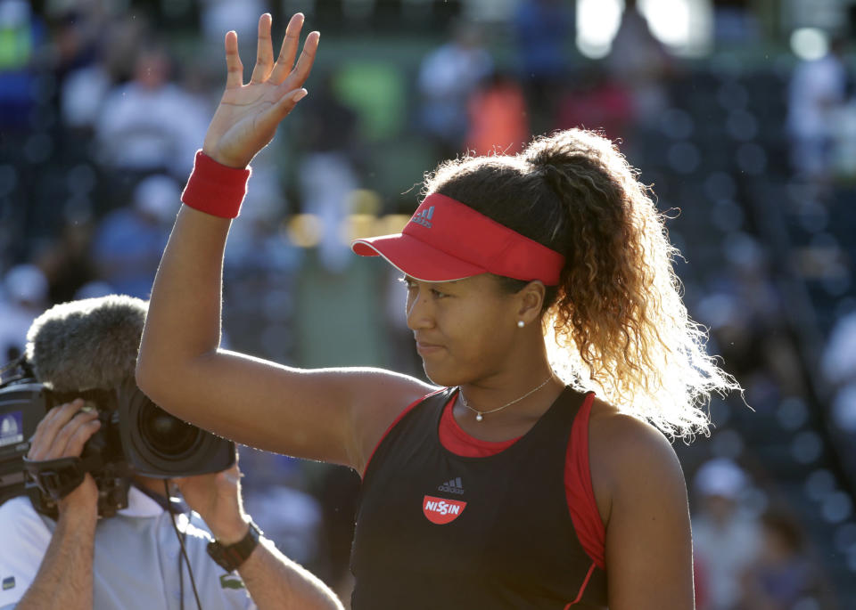 Naomi Osaka, of Japan, waves after defeating Serena Williams during the Miami Open tennis tournament, Wednesday, March 21, 2018, in Key Biscayne, Fla. Osaka won 6-3, 6-2. (AP Photo/Lynne Sladky)