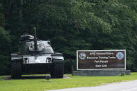A sign as well as a tank mark the entrance to Fort Pickett Wednesday, Aug. 25, 2021, in Blackstone, Va. Afghan refugees who have been prescreened by the U.S. Department of Homeland Security have been taken to Fort Lee as well as Fort Pickett according to Virginia Gov. Ralph Northam. (AP Photo/Steve Helber)