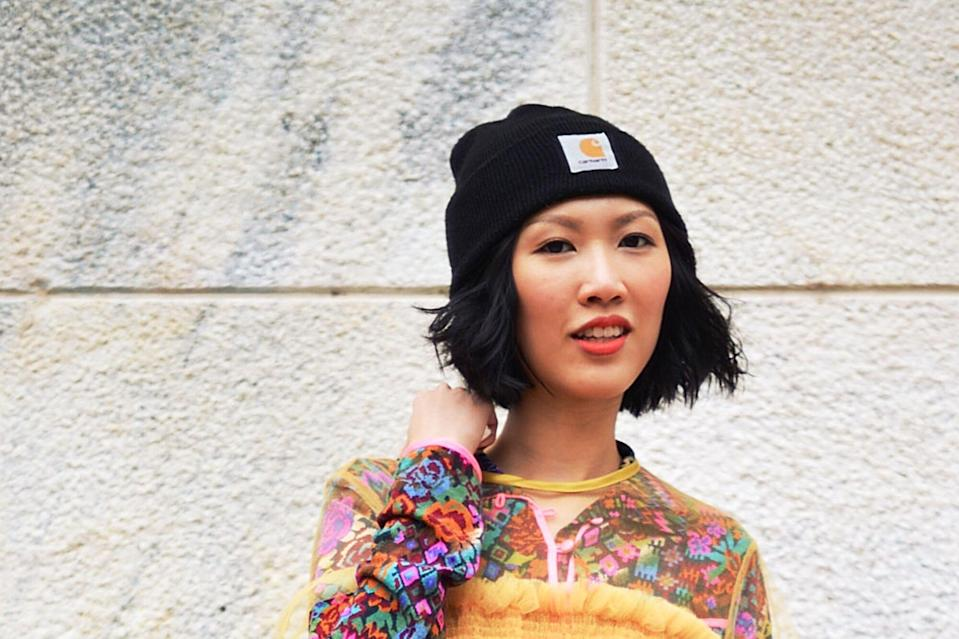 Everyone On Instagram Is Obsessed With This Stylish Beanie — and It Doubles As a Running Hat , MILAN, ITALY - SEPTEMBER 28: A guest poses wearing a Molly Goddard dress and a Carhart beanie before the Arthur Arbesser show during the Milan Fashion Week Spring/Summer 16 on September 28, 2015 in Milan, Italy. (Photo by Vanni Bassetti/Getty Images)