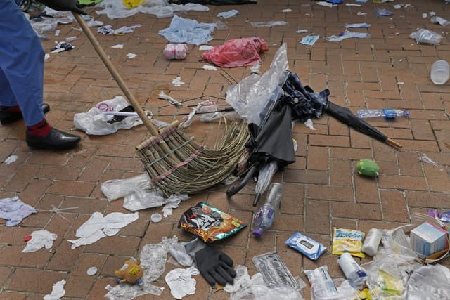 A worker cleans up detritus left in the aftermath of protests