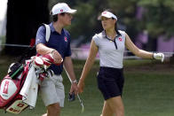 Albane Valenzuela, of Switzerland, and her brother and caddy, Alexis Valenzuela, walk the 11th fairway during a practice round prior to the women's golf event at the 2020 Summer Olympics, Monday, Aug. 2, 2021, at the Kasumigaseki Country Club in Kawagoe, Japan. (AP Photo/Matt York)