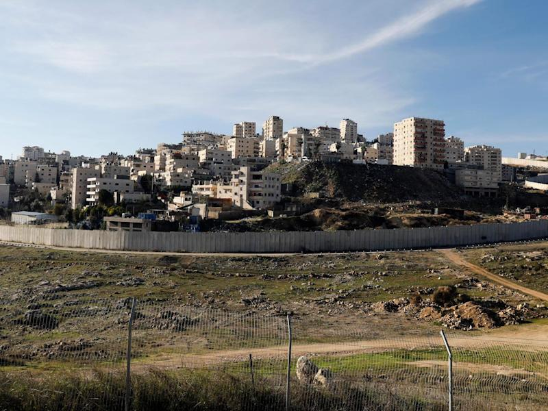 Israel's controversial separation wall in front of the Palestinian Shuafat refugee camp in the Israeli-annexed eastern sector of Jerusalem: Photo by AHMAD GHARABLI/AFP via Getty Images