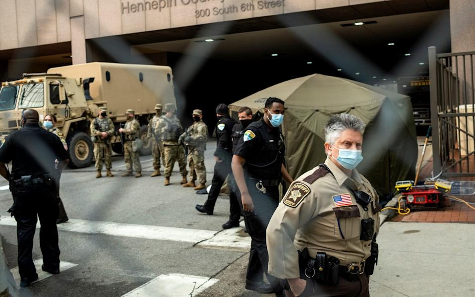 The National Guard stand watch outside the courthouse in Minneapolis - Stephen Maturen/Getty
