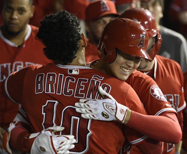 Los Angeles Angels' Shohei Ohtani, right, is greeted by Jose Briceno (10) after hitting a three-run home run against the Chicago White Sox during the third inning of a baseball game, Friday, Sept. 7, 2018, in Chicago. (AP Photo/David Banks)